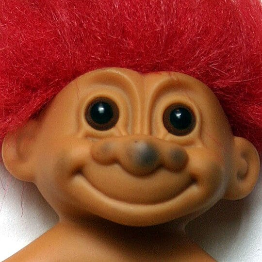 Toy troll with a dirty face