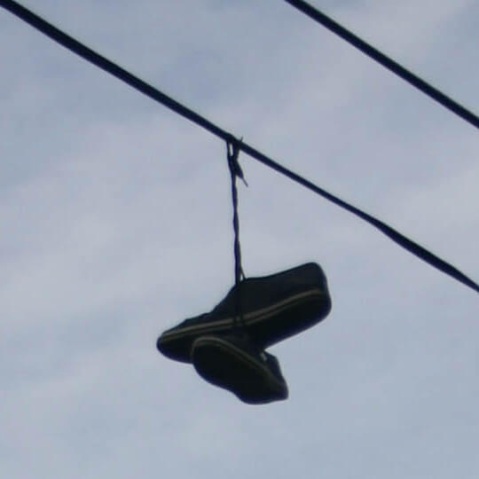 A victims' shoes thrown over cables to prevent retrieval